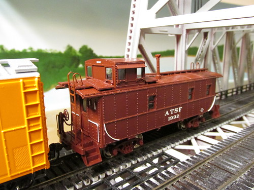 An Athearn model of an Atchison, Topeka & Santa Fe Railroad steel cupola caboose wearing the original pre 1966 color scheme, prior to systemwide caboose rebuilding at the Cleburne Texas Railroad Shops. by Eddie from Chicago