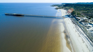 Image of Beach with a length of 1319 meters. pier muelle architecture aerial dji urbanexploration sand beach river trees forest sun sky