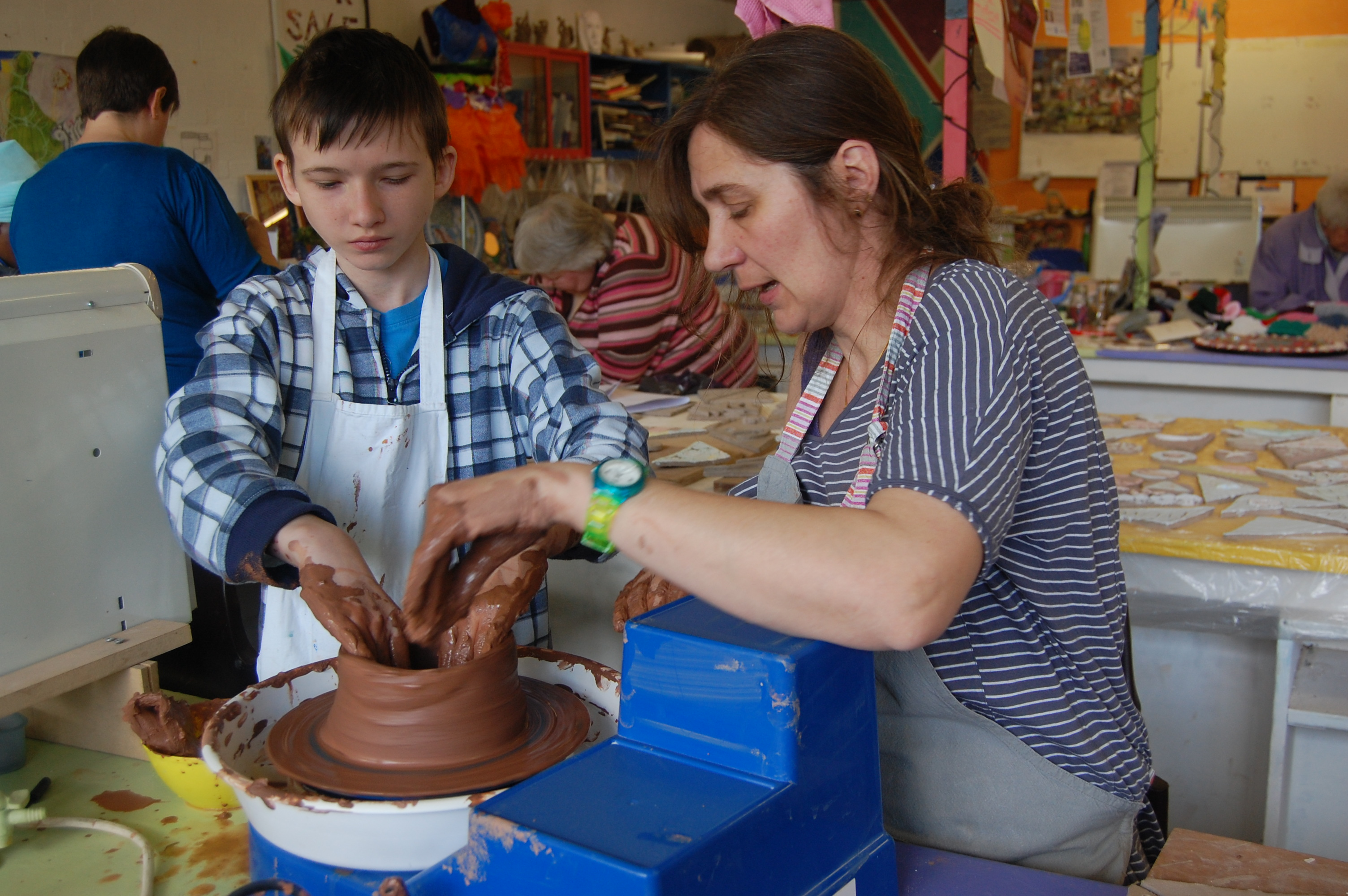 kid's pottery on the wheel