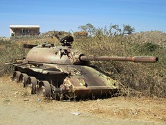 military(0.0), army(1.0), combat vehicle(1.0), weapon(1.0), vehicle(1.0), tank(1.0), self-propelled artillery(1.0), gun turret(1.0), cannon(1.0), land vehicle(1.0),