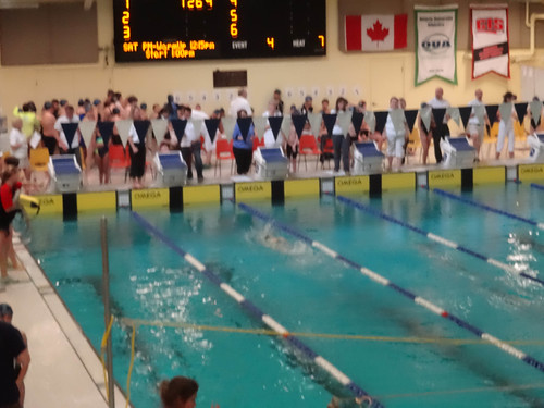 girl in green winning 100 m free
