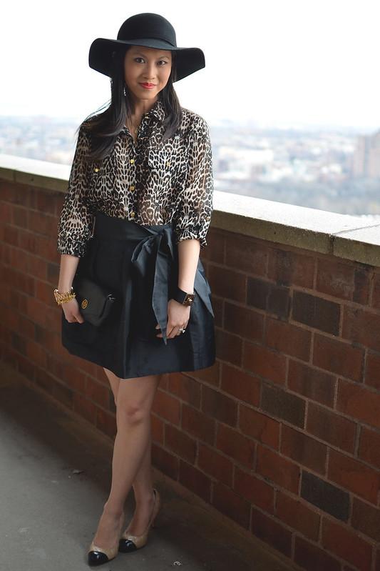 leopard blouse, black skater skirt, wide brim hat