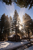 Sunburst through woodstove smoke - the cabins at Lincoln, Oregon by Steven David Johnson