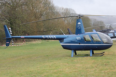 G-CGGS - 2009 build Robinson R44 Raven II, at the 2013 Cheltenham Festival