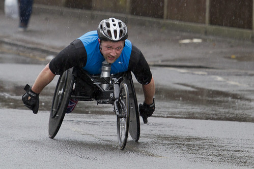 Wheelchair Race competitor in the rain - Reading Half Marathon 2013
