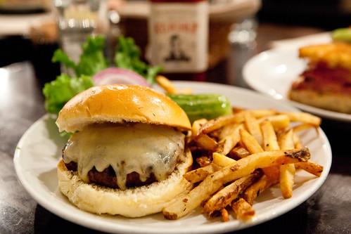 Gruyere cheeseburger with fries, tomato, red onion and lettuce