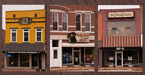 door white brick sign yellow retail facade awning triptych indiana sidewalk storefront smalltown forrent courthousesquare