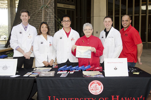 <p>President M.R.C. Greenwood with students and faculty from the UH Hilo College of Pharmacy.</p>