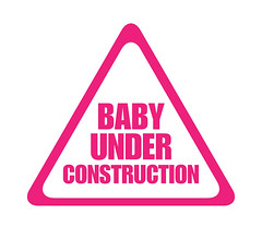 pink baby under construction