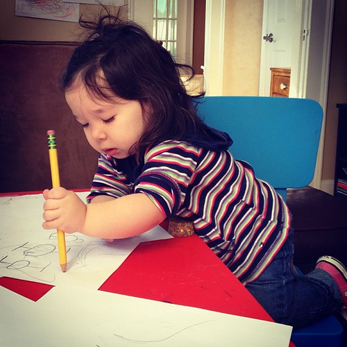 The littlest artist, hard at work (destroying her brother's tie fighters).