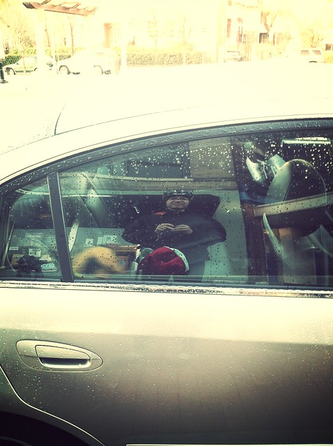Self-portrait in car window