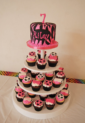 pink and black zebra print cupcake tower with soccer and cheer cupcakes