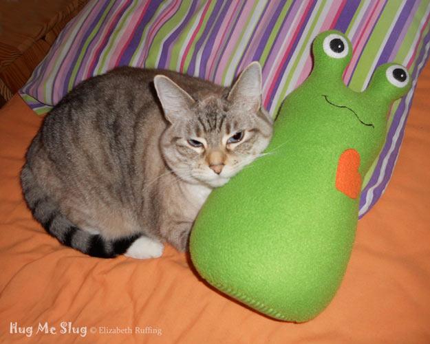 Kitty Cat cuddling with a green Hug Me Slug, original stuffed animal art toys by Elizabeth Ruffing