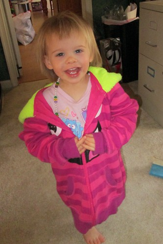 Lucy wearing her big sister's hoodie