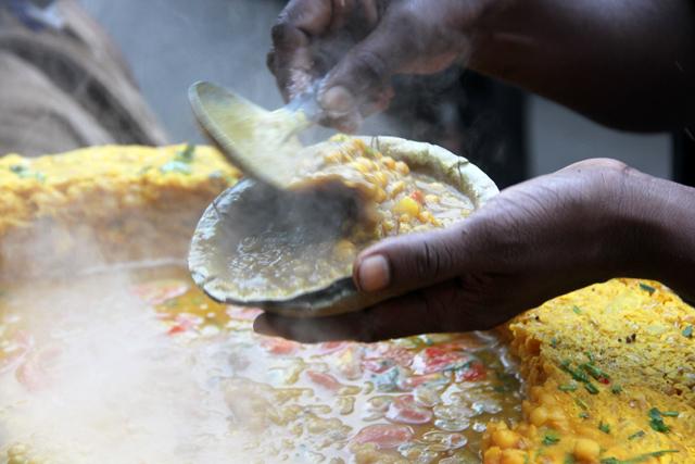 Mixing up a fresh bowl of ghugni chaat in Kolkata, India