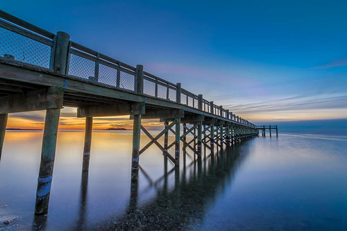 ocean beach night sunrise pier unitedstates connecticut shore boardwalk milford longislandsound silversandsstatepark pwpartlycloudy