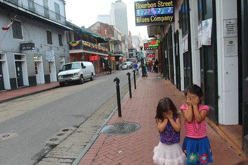 Day 180: Taking children for a stroll down Bourbon Street.