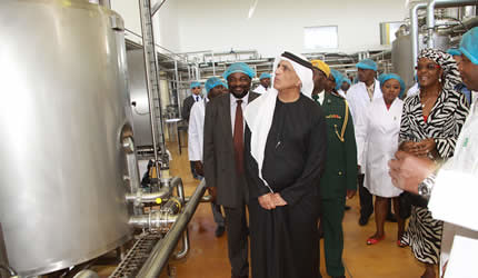 Sheikh Saud Bin Saqr Al Qasimi and First Lady Amai Grace Mugabe at Alpha Omega dairy in Mazowe. The Sheikh is visiting the Southern African state on business. by Pan-African News Wire File Photos
