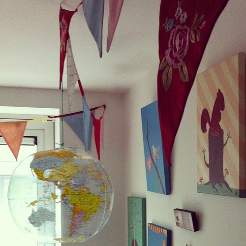 Bunting, a globe and original artwork in LB's bedroom.