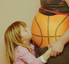 Pregnant Basketball Kiss