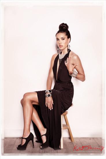 Sydney fashion marketing photography. Model wearing a black fashion necklace seated. Photographed by Kent Johnson.