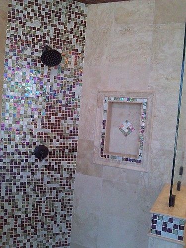 Travertine tile with glass designs