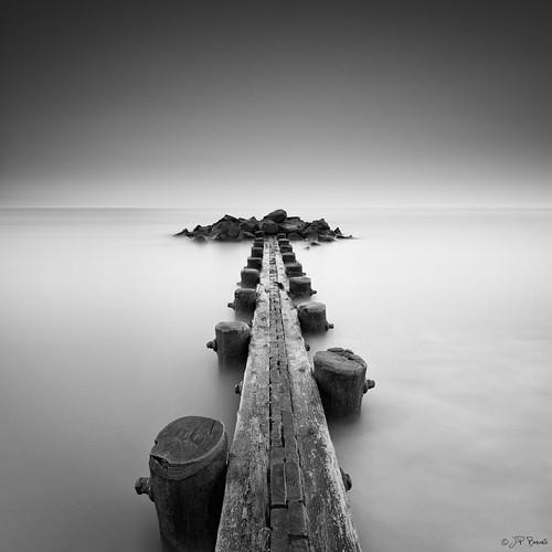 wood longexposure bw mist beach water fog rocks jetty tide horizon nj seawall boulders shore lee ethereal capemay current lumber 1740l delawarebay 5dii bigstopper theresnoleavingnow jpbenante