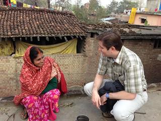 Marty talks to a woman farmer