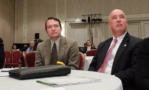 David Ryan McMullen (left) Oklahoma Rural Development State Director and Iowa State Director Bill Menner listen to an energy conservation presentation at the Ag. Outlook Forum. Photo by Lance Cheung