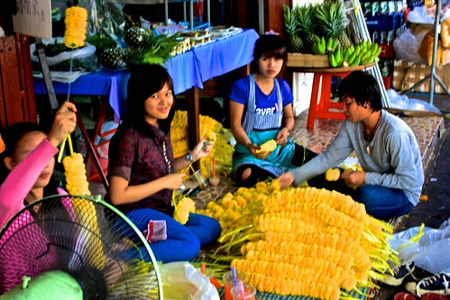at a large market full of flowers being made… mainly for use on all of the shrines in Bangkok