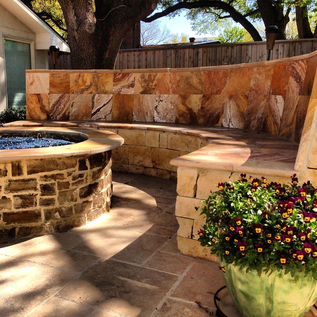Firepit with wall veneer and recycled glass accents