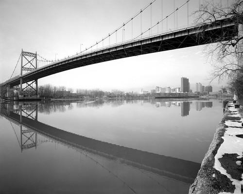 bridge skyline river explore 4x5 powerplant ilfordfp4plus bwblackandwhitebw sekonicl758dr kodakhc110developerdilutionb graflexgraphicviewcameraii schneider75mmf8superangulonlens