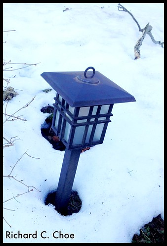 Lamp in Snow by rchoephoto