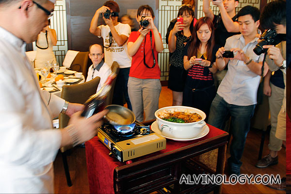 Chef demonstration for the artful preparation of the Chinese New Year Flambé Pen Cai