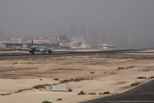 Qatar Airways jet taking off from runway 33 at Doha