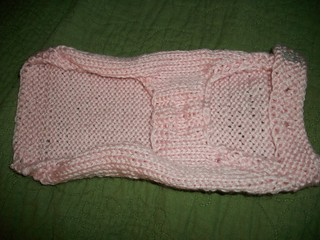 Underbelly of the pink dog sweater.