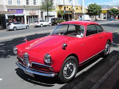 executive car(0.0), family car(0.0), alfa romeo giulietta(0.0), alfa romeo giulietta(0.0), supercar(0.0), sports car(0.0), automobile(1.0), automotive exterior(1.0), alfa romeo(1.0), wheel(1.0), vehicle(1.0), automotive design(1.0), compact car(1.0), antique car(1.0), classic car(1.0), land vehicle(1.0),