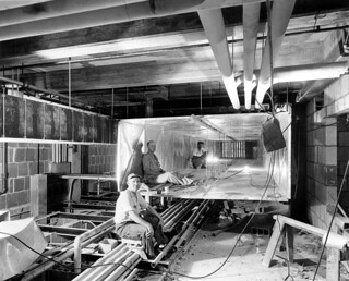 Workers inside Ductwork during the Renovation of the White House, 07/19/1951