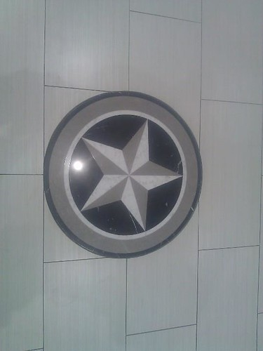 Commercial porcelain tile with star medallion insert at Spa n Nail salon