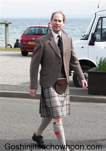 2008 prince-edward-checking-out-professor-muros-aloha-shirt-as-professor-checks-out-the-princes-kilt-balintore-scotland-2008