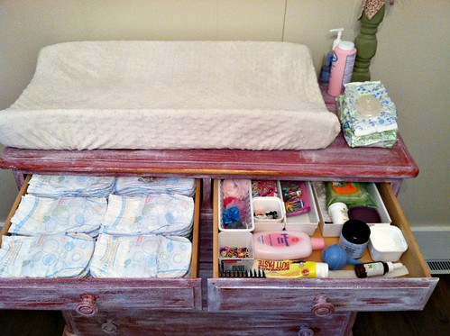 I keep the left drawer stocked with diapers and use the right drawer for hair accessories lotion diaper rash cream other toiletries and some medicine. & How I Store and Organize All Our Baby Clothes - Andrea Dekker
