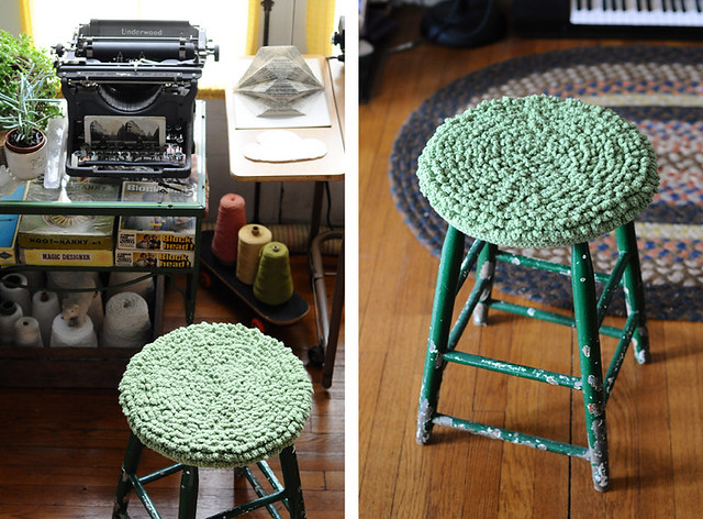 green crocheted stool cover