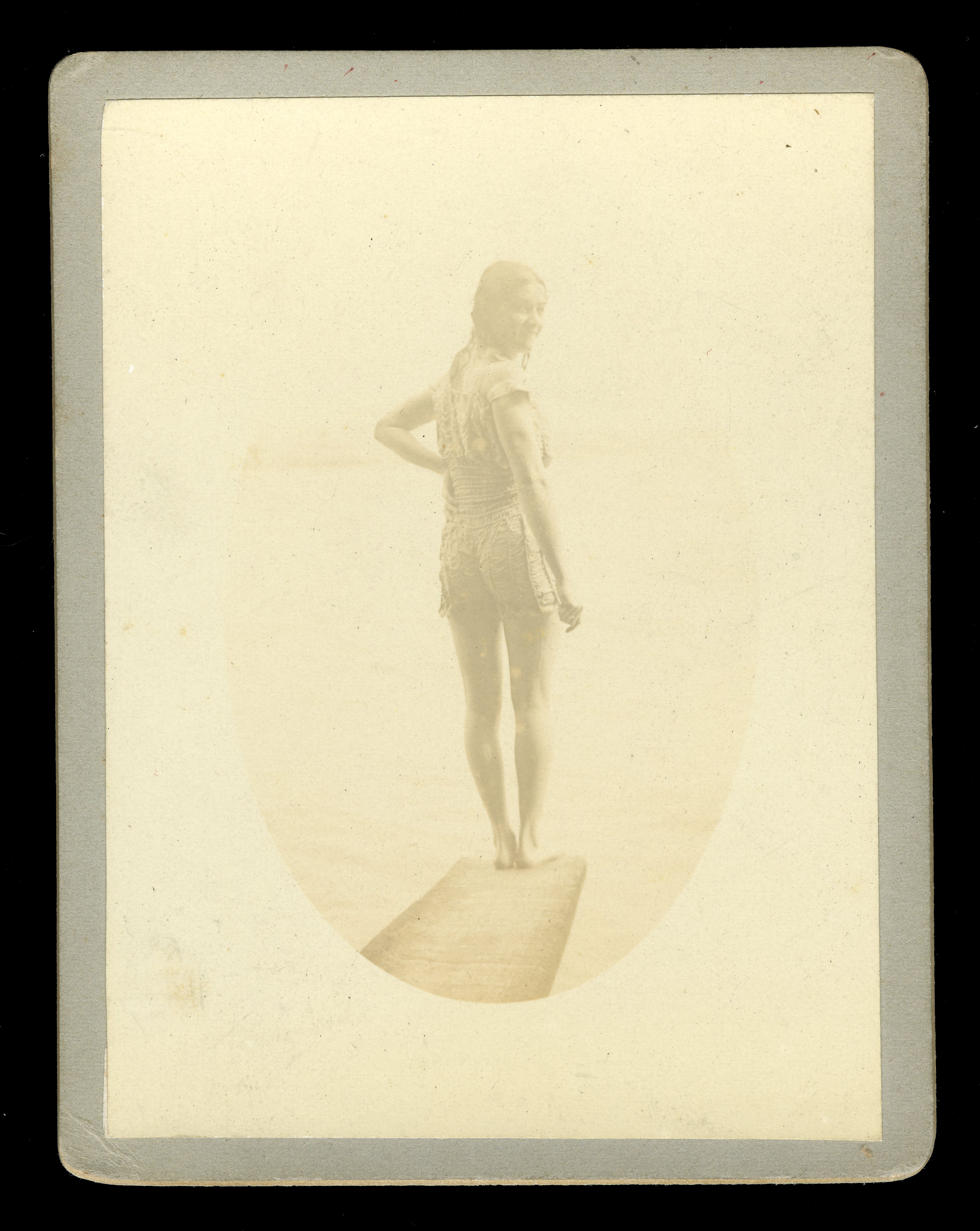 Photograph of Beatrice Kerr standing on a diving board