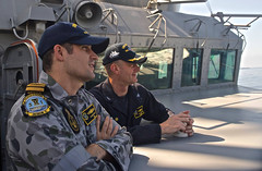 Lt. Cmdr. Aaron Scott left, with Capt. Charles Johnson, commander of Destroyer Squadron (DESRON) 31, is in the midst of a two-year tour on the DESRON staff. (U.S. Navy photo)