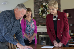 State Rep. Tami Zawistowski, right, reviews plans for upgrades at Maple Court senior housing complex.