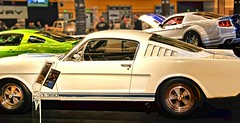 shelby mustang(0.0), first generation ford mustang(0.0), automobile(1.0), boss 302 mustang(1.0), wheel(1.0), vehicle(1.0), automotive design(1.0), auto show(1.0), antique car(1.0), land vehicle(1.0), muscle car(1.0), sports car(1.0),