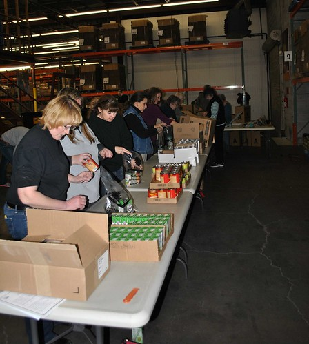 USDA Employees recently helped to pack nearly 10,000 food items into backpacks for local children at a food distribution center in Topeka.