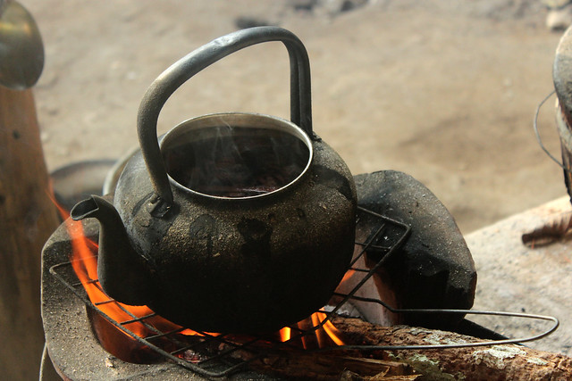 Tea boiling over a wood fire stove in Thailand