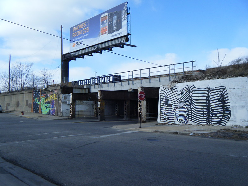 Murals on both sides of Ashland Ave