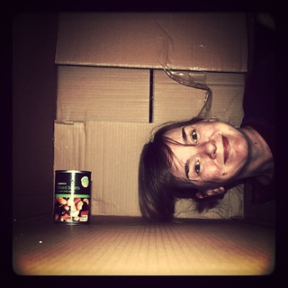 Portrait in a cardboard box with The Red Hot Chilli Beanz